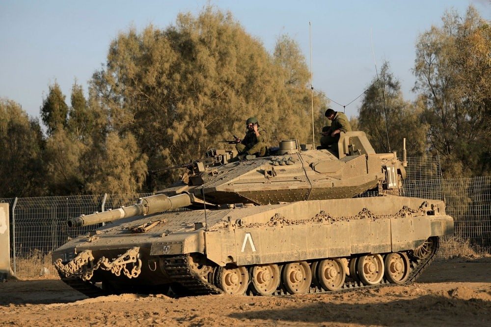 Israeli soldier jumps of a tank near the border with Gaza, Oct. 30.