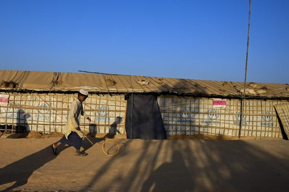 A young Rohingya refugee plays in Balukhali refugee camp, Ukhia, Feb. 4, 2019.