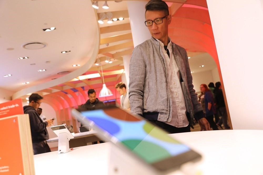 A man looks at Google's new Pixel 2 phones at a New York City pop-up shop.