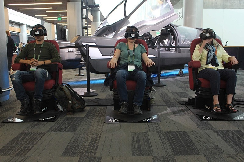 Attendees at an Oculus Connect conference in San Jose, California, take a futuristic ride in virtual reality using Samsung Gear VR headsets on October 11, 2017. (AFP Photo)
