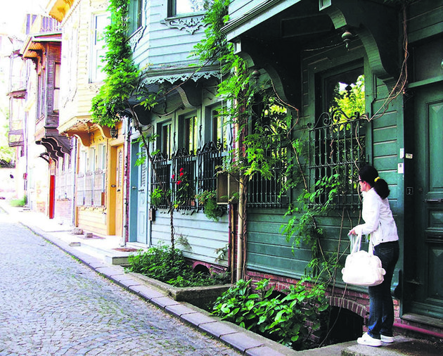 The streets of Kuzguncuk are filled with old wooden houses that have been restored and painted in different colors.