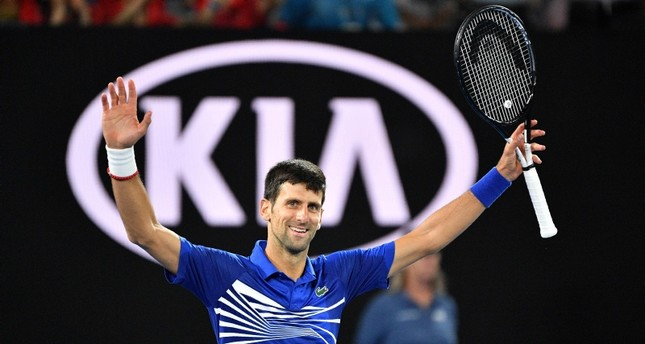Serbia's Novak Djokovic celebrates his victory against Spain's Rafael Nadal during the men's singles final on day 14 of the Australian Open tennis tournament in Melbourne on January 27, 2019. AFP Photo