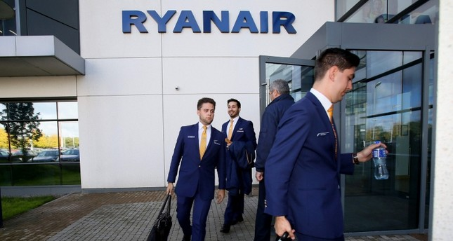 In this file photo taken on September 21, 2017 staff leave Ryanair headquarters at Airside Business Park in Dublin. (AFP Photo)