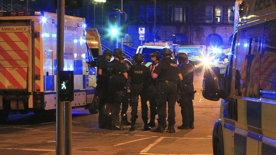 Armed police gather at Manchester Arena after reports of an explosion at the venue during an Ariana Grande concert in Manchester, England Monday, May 22, 2017. (AP Photo)