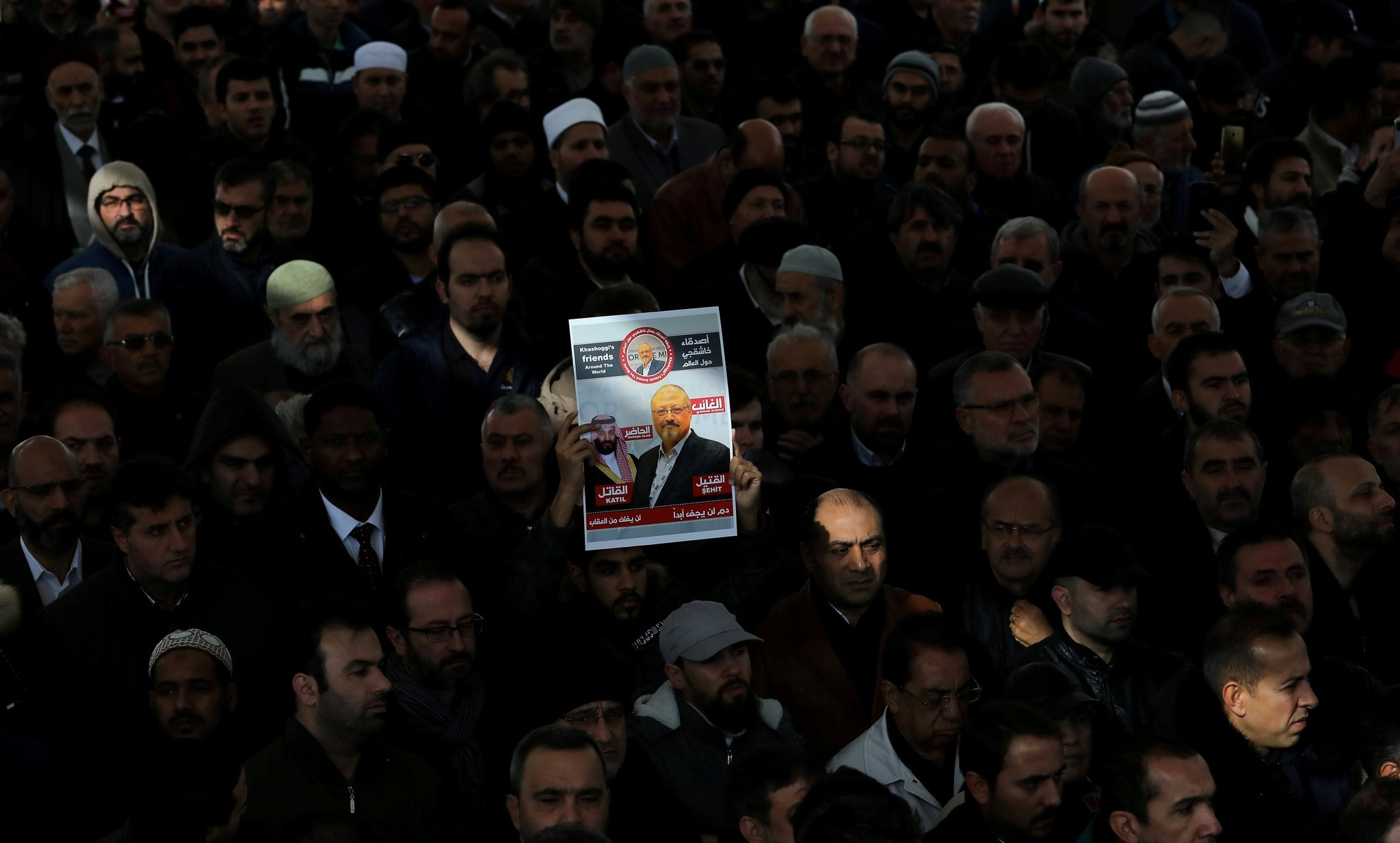 People attend a symbolic funeral prayer for slain Saudi journalist Jamal Khashoggi at the courtyard of Fatih Mosque, Istanbul, Nov. 16, 2018.