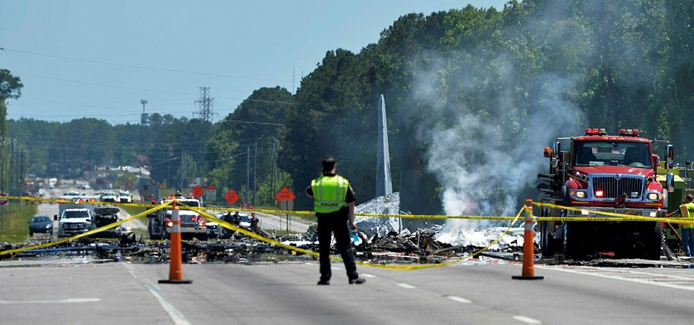 First responders work the scene of a deadly crash of an Air National Guard C-130 cargo plane from Puerto Rico in Port Wentworth, Ga., May 2, 2018. (AP Photo)