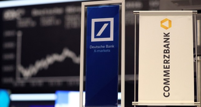 Banners of Deutsche Bank and Commerzbank are pictured in front of the German share price index, DAX board, at the stock exchange in Frankfurt, Germany, September 30, 2016. (Reuters Photo)