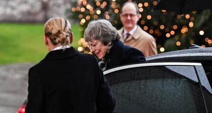 UK PM May gets stuck in car during Berlin visit