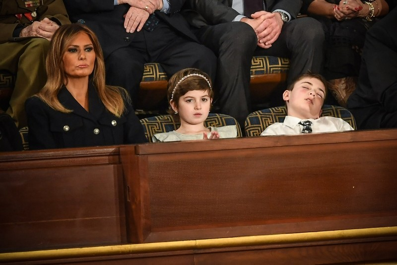 In this file photo taken on February 5, 2019 US First lady Melania Trump (L) with Grace Eline and Joshua Trump, special guests of President Donald Trump, attend the State of the Union address at the US Capitol in Washington, DC. (AFP Photo)