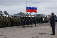President Vladimir Putin ordered withdrawal of Russian troops from Syria during his surprise visit to the Russian air base in the war-torn country Monday.