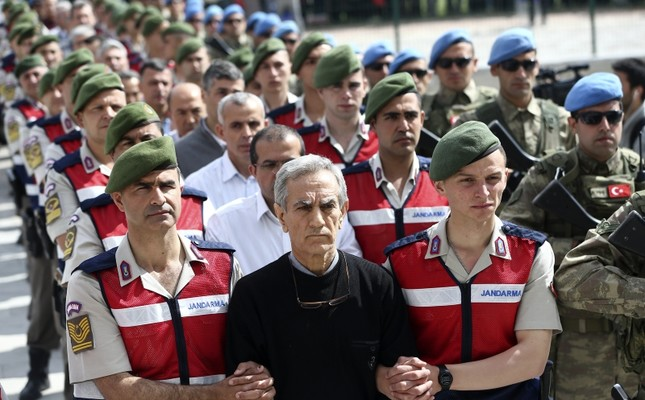 This file photo shows the defendants of the main coup attempt trial, with former Air Force Commander Gen. Akın Öztürk in the forefront, being brought to the courthouse in Sincan Prison Complex.