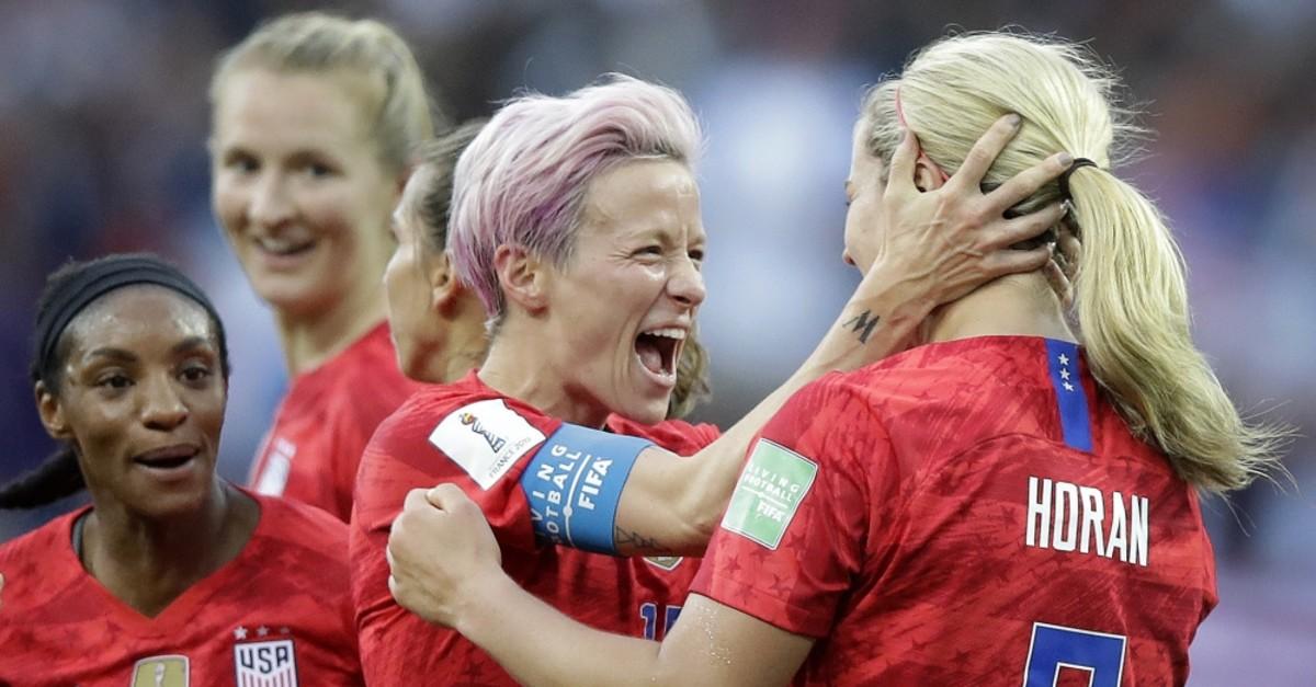 United States' scorer Lindsey Horan (R), celebrates their side's 3rd goal with Megan Rapinoe, June 11, 2019.