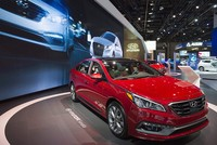Hyundai Motor Co. reported Wednesday a 39 percent drop in its fourth-quarter income to the lowest level in seven years, hit by weak demand in South Korea, the United States and key emerging markets...