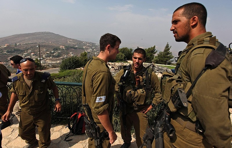 Israeli soldiers stand in an observation point on the Israeli border village of Misgav Am. (EPA Archive Photo)