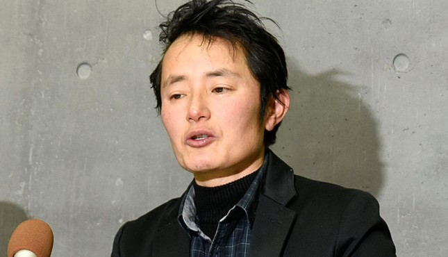 In this Thursday, Jan. 24, 2019, photo, Takakito Usui, a transgender man, cries while speaking during a press conference after Japan's Supreme Court handed down in Okayama, western Japan. (AP Photo)
