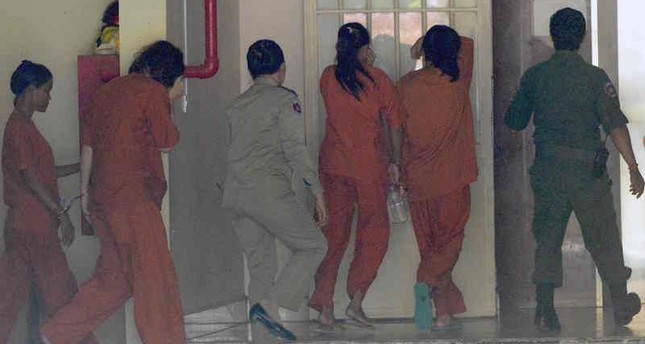 Tammy Davis-Charles was convicted by Phnom Penh Municipal Court Thursday for falsifying documents and acting as an intermediary in a commercial surrogacy operation. AFP Photo.
