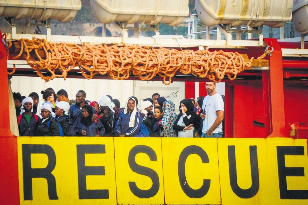 Migrants wait to disembark from the NGO Medecins Sans Frontier Vos Prudence ship after being rescued at sea, at Salerno's harbor, Italy, July 14.