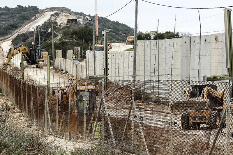 Israeli workers construct a wall along the Israeli - Lebanon border, in the coastal town of Naqoura, south Lebanon (EPA File Photo)
