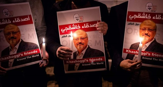 People lit candles and held posters picturing murdered Saudi journalist Jamal Khashoggi during a gathering outside the Saudi Consulate in Istanbul, Oct. 25.