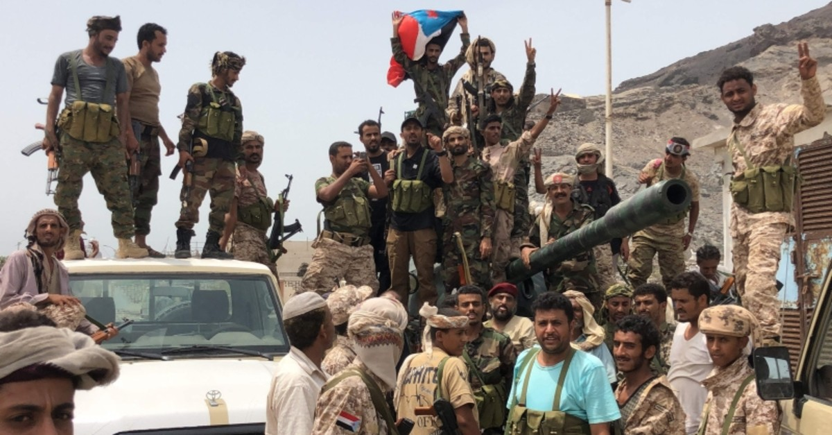 Yemeni supporters of the southern separatist movement pose for a picture in Khor Maksar, in the Yemeni southern port city of Aden on August 10, 2019. (AFP Photo)