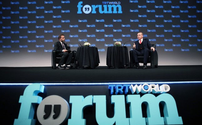 President Recep Tayyip Erdoğan(R) speaks at the TRT World Forum and answers questions from Fatih Er(L), the TRT World News Coordinator.
