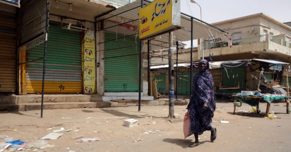 A woman walks down an empty street closed in the Omdurman market, near Khartoum, Sudan, June 8, 2019. (EPA Photo)