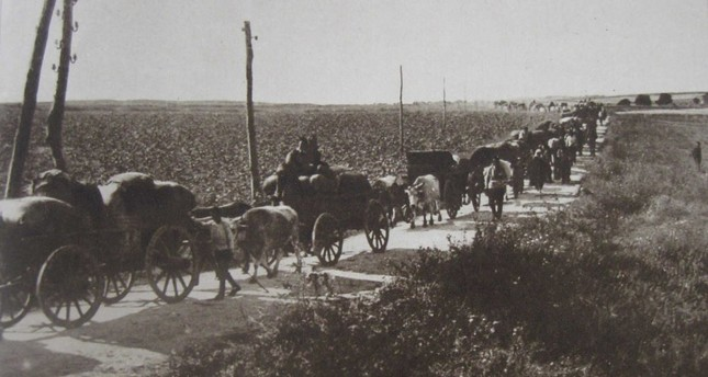The Karamnlides traveling on their carts, leaving their homelands behind during the population exchange between Turkey and Greece.