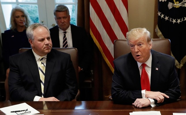 In this Jan. 2, 2019, file photo, President Donald Trump speaks during a cabinet meeting at the White House, Wednesday, Jan. 2, 2019, in Washington, as Acting Interior Secretary David Bernhardt listens. (AP Photo)