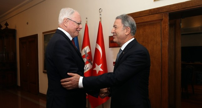 In this Jan. 28, 2019 file photo, Defense Minister Hulusi Akar, right, shakes hands with U.S. envoy James Jeffrey. (AA Photo)