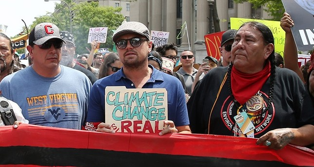 Thousands gather in Washington to protest Trump's climate policies