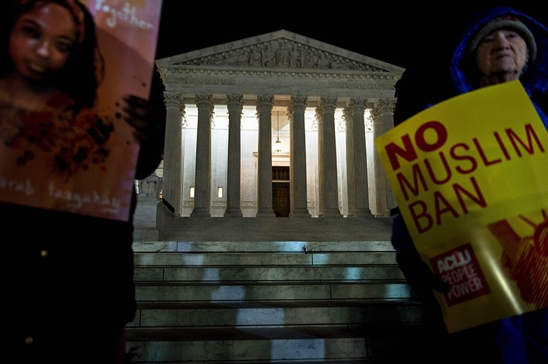 Activists protest the travel ban outside the US Supreme Court December 7, 2017 in Washington, DC. (AFP Photo)