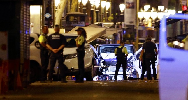 Police officers stand next to the van involved on an attack in Las Ramblas in Barcelona, Spain, Aug. 17, 2017. (AP Photo)