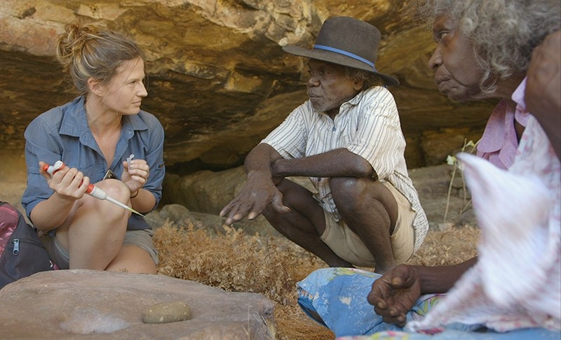 Researcher Elspeth Hayes talking with Mark Djandjomerr and traditional owner May Nango as she extracts samples at cave near Madjedbebe site in Kakadu region, Australia, July 14, 2017. (Vincent Lamberti-Gundjeihmi Aboriginal Corporation via Reuters)