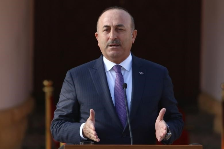 Turkey's Foreign Minister Mevlut Cavusoglu speaks to the media during a visit in Nicosia. (REUTERS Photo)