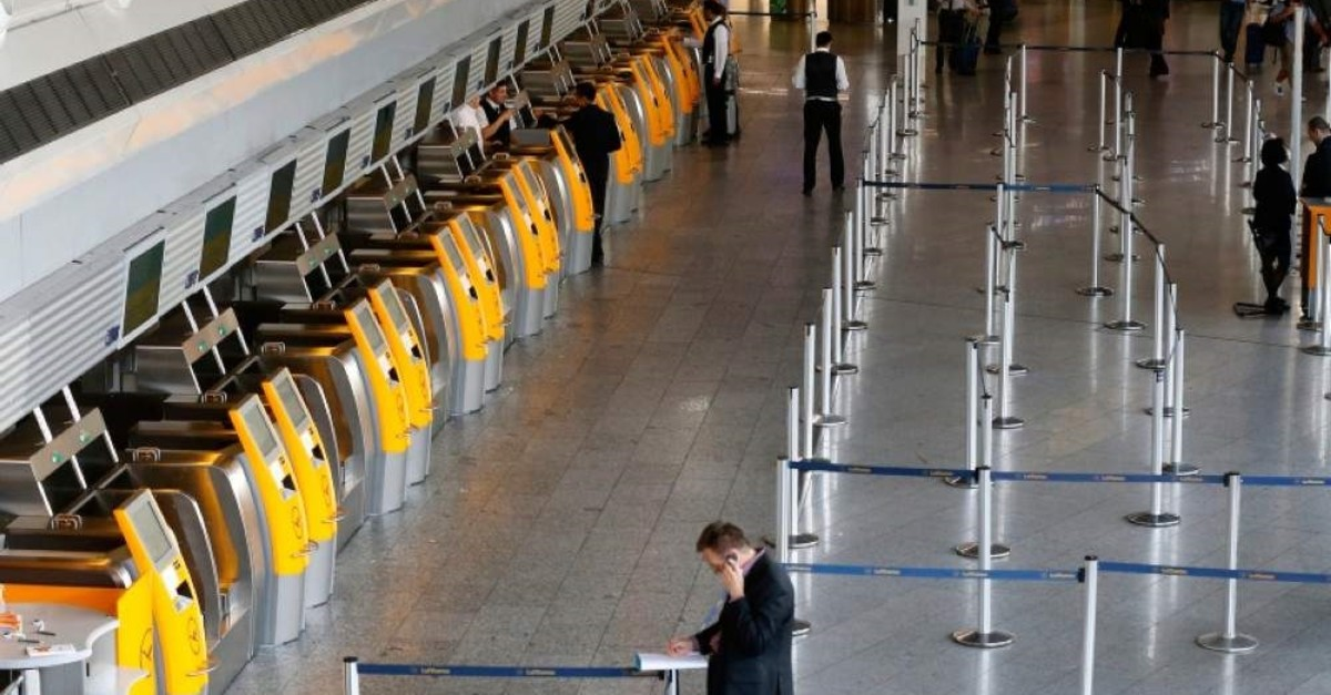 In This Sept. 5, 2014 file photo a passenger makes a phone call near-empty Lufthansa counters when pilots of Lufthansa went on a six hours warning strike at the airport in Frankfurt, Germany. (AP Photo)