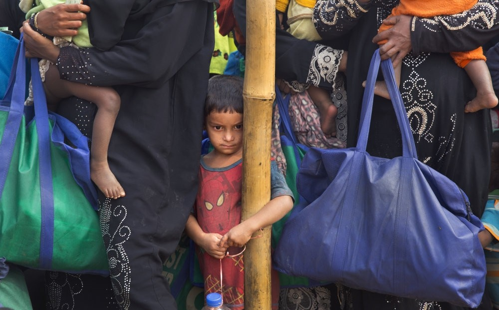 A Rohingya Muslim boy stands in a queue outside a food distribution center at Balukhali refugee camp, Cox's Bazar, Bangladesh, Jan. 15.