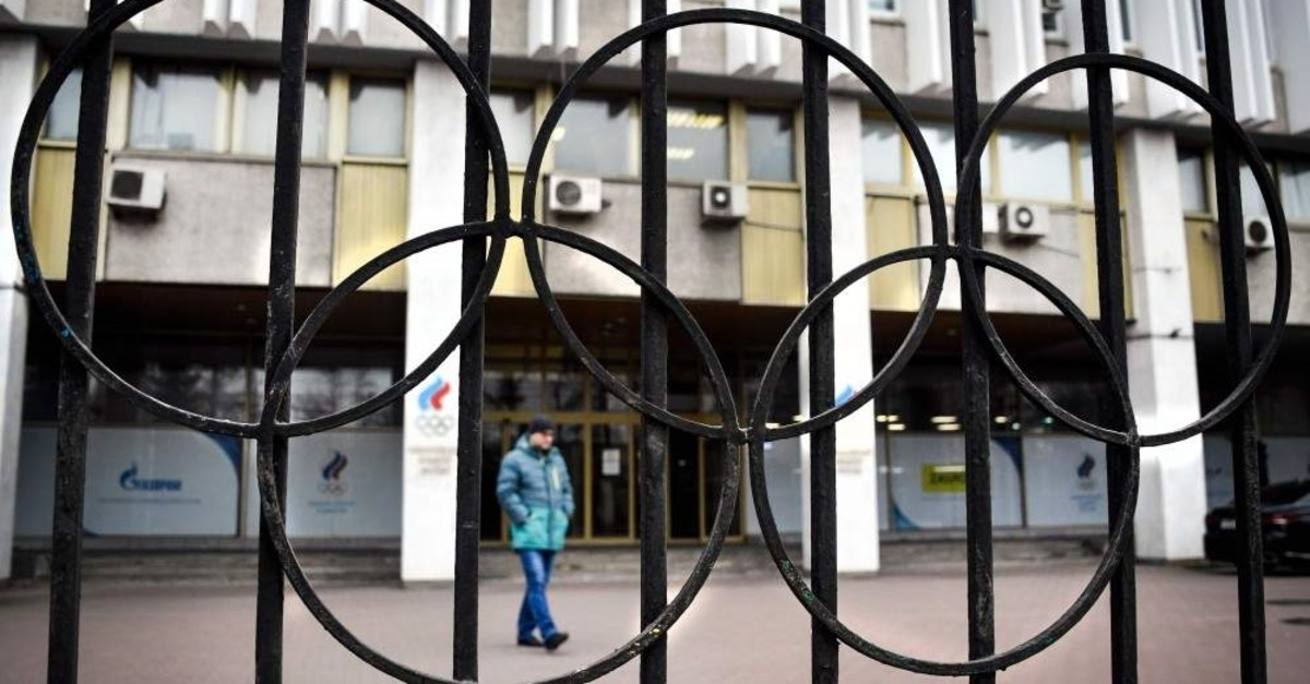 A man walks in front of the Russian Olympic Committee (ROC) headquarters, Moscow, Nov. 26, 2019. (AFP Photo)