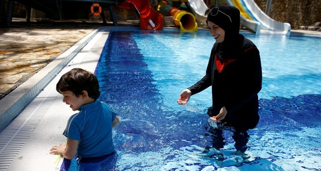 Guests enjoy the pool at Wome Deluxe Hotel, a halal friendly holiday resort, in Alanya, Turkey (Reuters Photo)