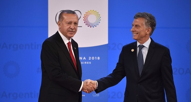 President Recep Tayyip Erdoğan (L) is welcomed by Argentina's President Mauricio Macri at Costa Salguero in Buenos Aires during the G20 Leaders' Summit, on Friday.