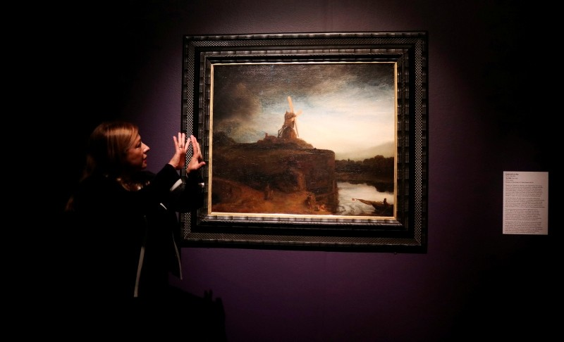 In this Oct. 24, 2018 photo, New Orleans Museum of Art curator Vanessa Schmid describes ,The Mill, by Rembrandt van Rijn, as one of America's great treasure. (AP Photo)