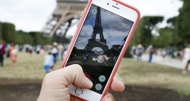The 'Pokemon Go' app on the screen of a smartphone in Paris. Pokemon is the most popular example of augmented reality technology.