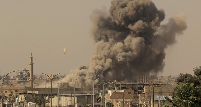 Smoke rises after an air strike during fighting between U.S.-backed fighters and Daesh terrorists in Raqqa, Syria, Aug. 15, 2017. (Reuters Photo)