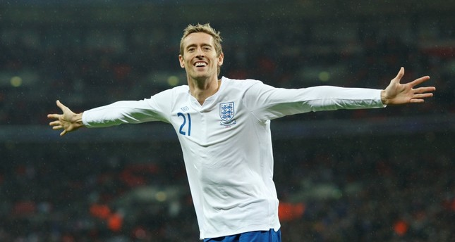 Peter Crouch celebrates scoring the first goal for England against France, Nov. 17, 2010.