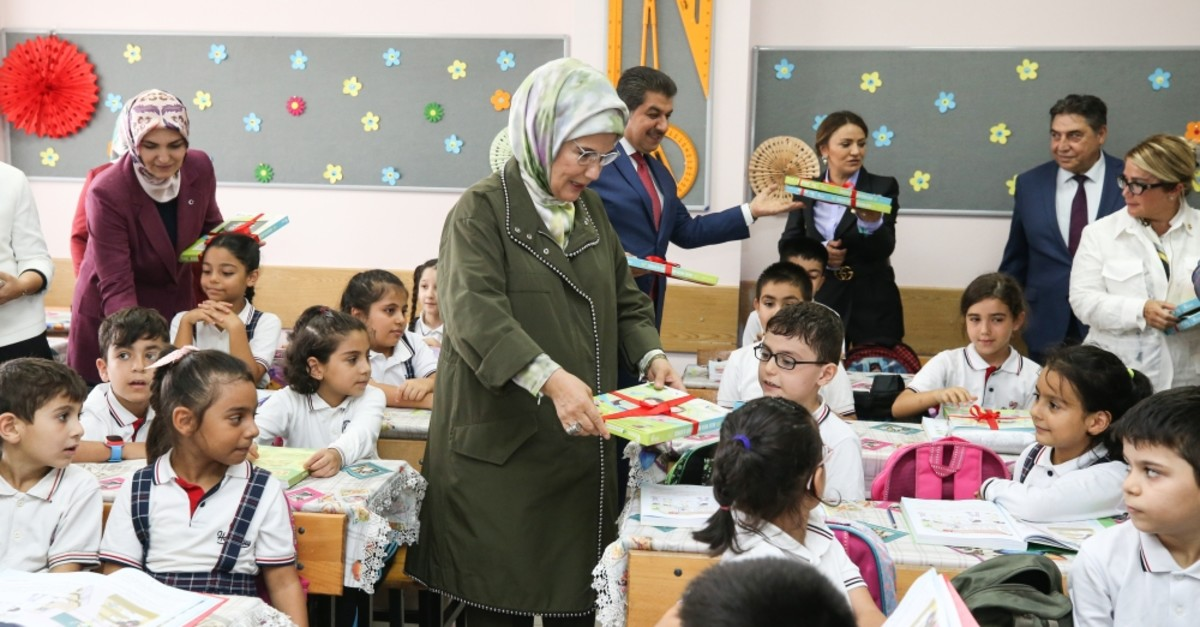 First lady Emine Erdou011fan personally delivered notebooks to students at a school in Esenler, Isanbul, Sept. 13, 2019.