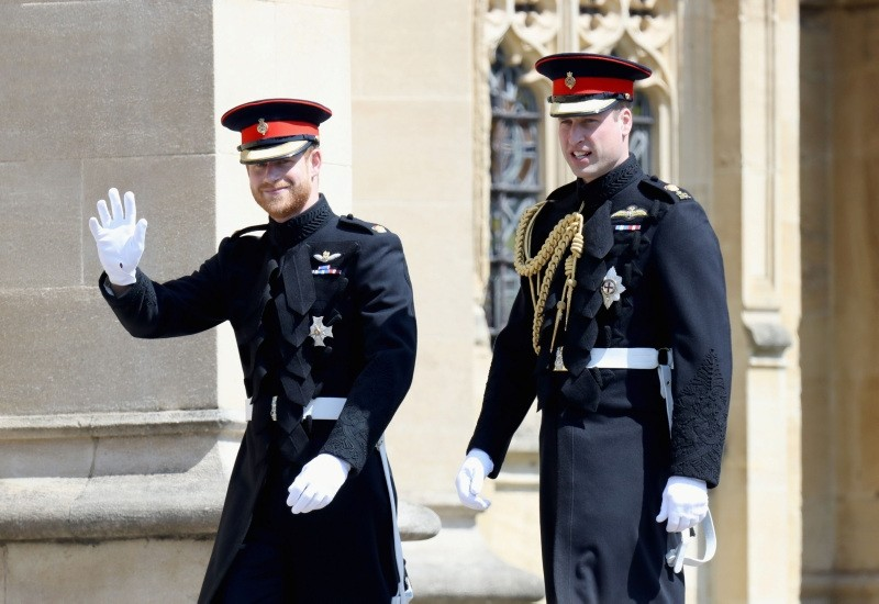 Britain's Prince Harry, Duke of Sussex (L) and Prince Harry's brother and best man Prince William, Duke of Cambridge arrive for the wedding ceremony of Britain's Prince Harry, Duke of Sussex and US actress Meghan Markle at St George's Chapel, Windsor Castle, in Windsor, on May 19, 2018