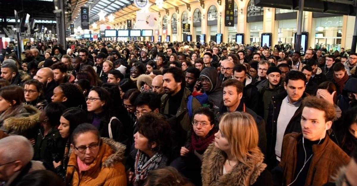 Commuters wait for their train at the Gare Saint-Lazare train station, Paris, Dec. 16, 2019. (AFP Photo)