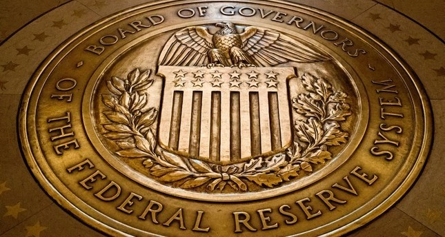 In this Feb. 5, 2018, file photo, the seal of the Board of Governors of the United States Federal Reserve System is displayed in the ground at the Marriner S. Eccles Federal Reserve Board Building in Washington. AP Photo
