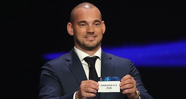 Former Galatasaray scorer Wesley Sneijder shows the name of the Lions during the UEFA Champions League group stage draw at the Grimaldi Forum, in Monaco, Thursday, Aug. 29, 2019. (AP Photo)