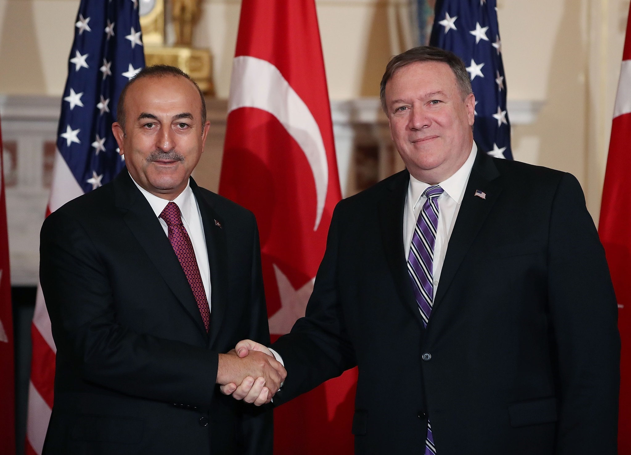 Secretary of State Mike Pompeo, right, greets Turkish Foreign Minister Mevlu00fct u00c7avuu015fou011flu before a meeting at the State Department, Washington, June 4.