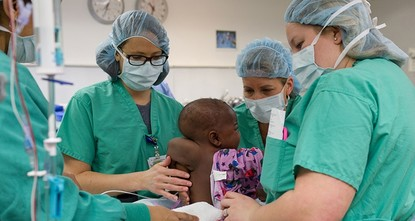 pA baby girl from the Ivory Coast born with four legs and two spines has been successfully separated from a parasitic twin in a rare and complex surgery at a Chicago hospital./p  pTen-month-old...